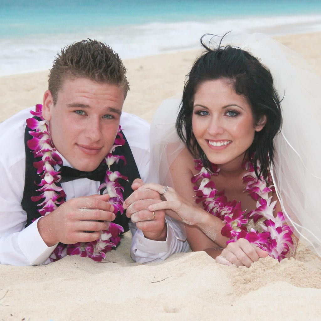 barefoot delight beach wedding package couple in sand