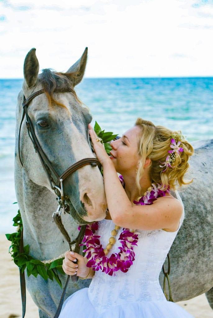 sweet hawaii wedding bride with horse