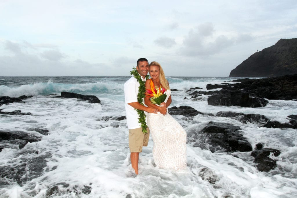 makapuu beach wedding couple in the water