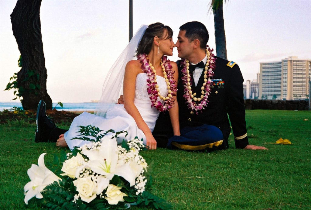 waikiki beach wedding couple on the grass